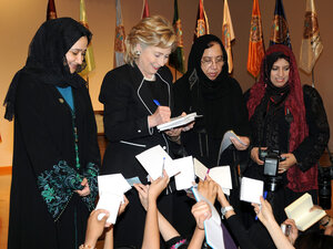 Secretary of State Hillary Clinton gives her autograph to students in Jeddah, Saudi Arabia.