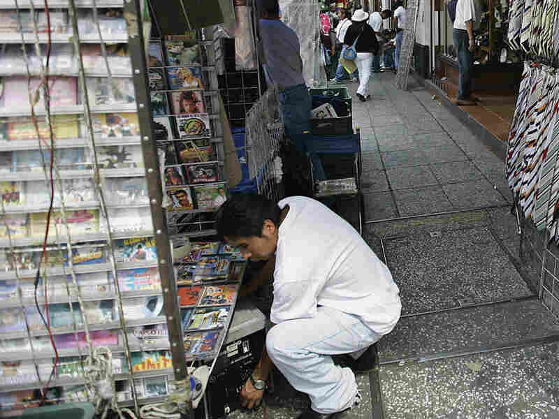 A street vendor sells music CDs in Mexico City