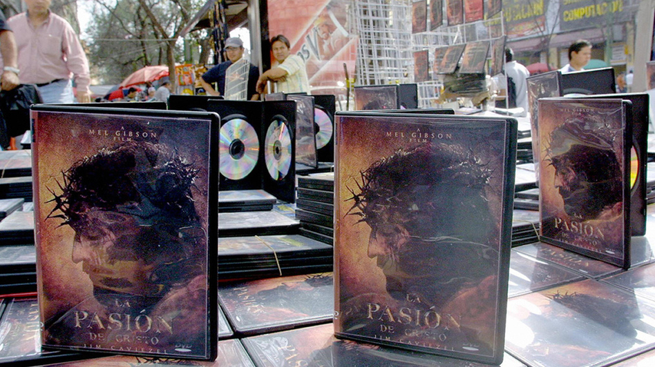 Pirated DVD copies of Mel Gibson's <em>The Passion of the Christ</em> sold for 30 Mexican pesos each, less than $3, in Mexico City in 2004. The illegal copies were available weeks before the movie premiered in theaters in Mexico.