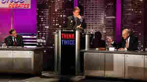 Rashid Khalid, John Donvan and Stuart Eizenstat participate in an 'Intelligence Squared' debate.