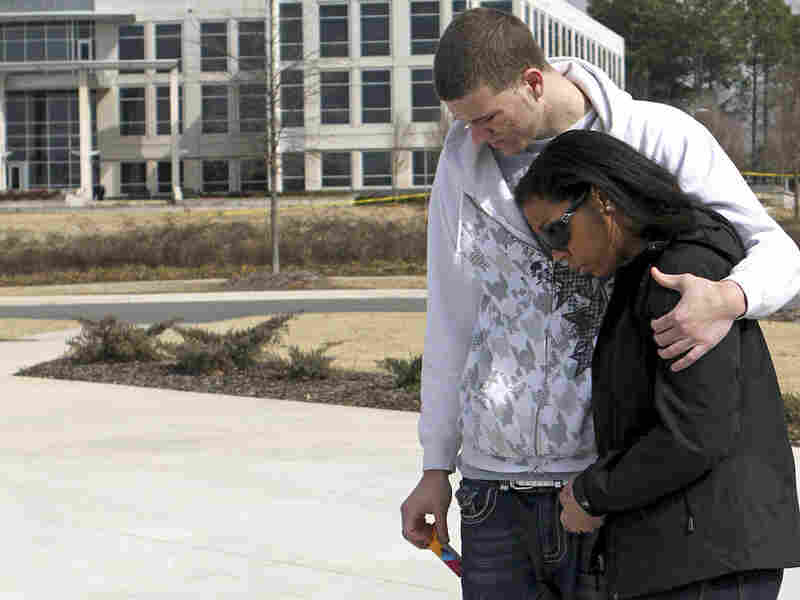 Mourners at the University of Alabama comfort one another after the fatal shooting on Feb. 12.