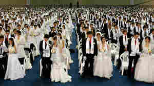 Couples from around the world participate in a mass wedding ceremony in Goyang, South Korea.