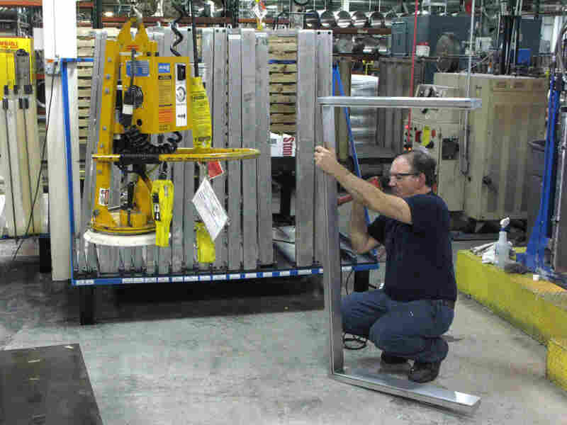 Darryl Kershner, an employee with  Quadrant Engineering Plastic Products, on the factory floor.