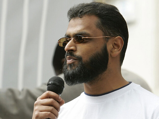 Former Guantanamo Bay detainee Moazzam Begg speaks outside the extradition hearing of a British terrorism suspect in London. In 2007, Begg was a speaker at a weeklong conference organized by Abdulmutallab.