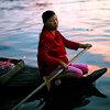 Woman in floating village on Tonle Sap Lake near Siem Reap, Cambodia