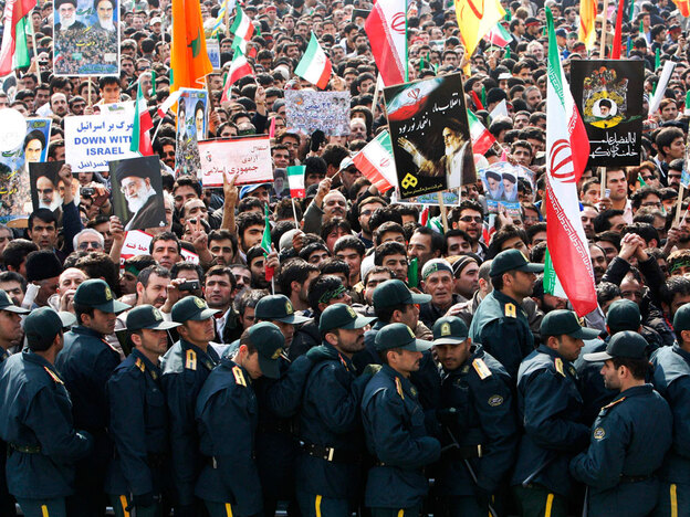 Police officers stand guard at a pro-government rally on Feb. 11 commemorating the anniversary of the 1979 Islamic revolution. Foreign media were banned from covering the opposition protests.