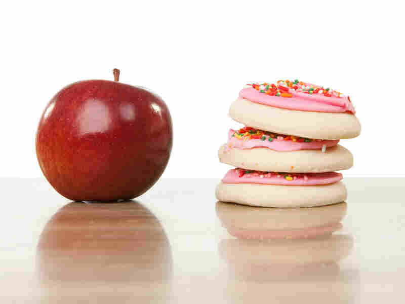 An apple and a stack of cookies