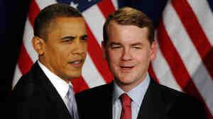 Obama greets Sen. Bennet before speaking at fundraiser.