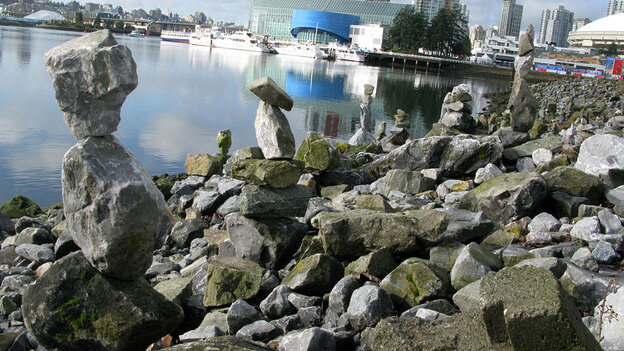 Stacks of rocks built by passersby near the Olympic Village in Vancouver.  The piles are reminiscent of the inukshuk, a kind of stone cairn found in the Arctic that has been adopted as the official symbol of the 2010 Winter Olympics. (NPR)