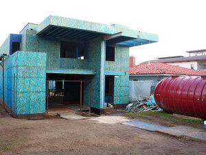 Paul Song's home is being built with a large rain storage tank.