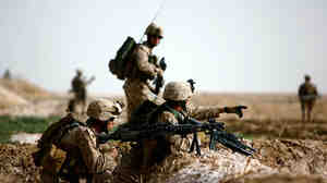 A lieutenant issues orders as U.S. Marines come under Taliban sniper fire on the northeast of Marjah