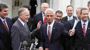 Florida Gov. Charlie Crist (third from left) and New York Gov. David Patterson (fourth from left)