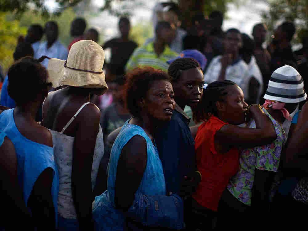 Women wait in a food distribution line in Port-au-Prince.