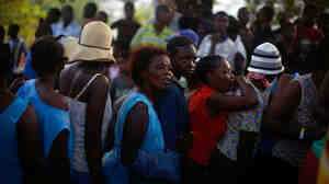 Women wait in a food distribution line in Port-au-Prince.