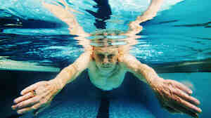 A man swims in a pool