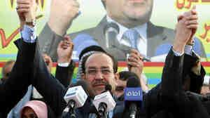 Iraqi Prime Minister Nouri al-Maliki campaigns in Basra, in southern Iraq, Feb. 20