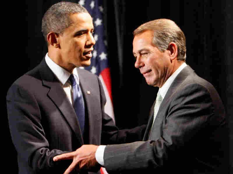 President Obama shakes hands with House Minority Leader John Boehner.