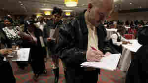William Wright, of Detroit, fills out an application while standing in line at a job fair Feb. 10