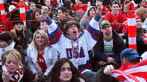 American Paul Turek watches the USA hockey game against Canada in Vancouver.