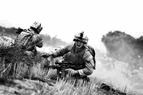 A Marine yells for help while under heavy fire from a machine gun in the Helmand River Valley in Hel