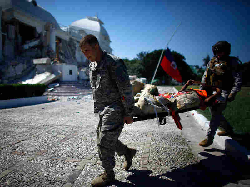 U.S. soldiers unload a patient from a helicopter in Port-au-Prince, Haiti