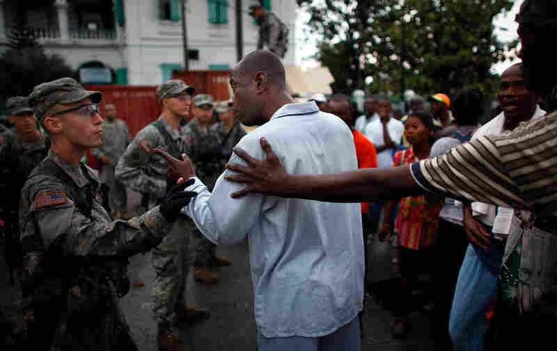 Haitian man in Port-au-Prince asks soldiers from the 82nd Airborne for tents.