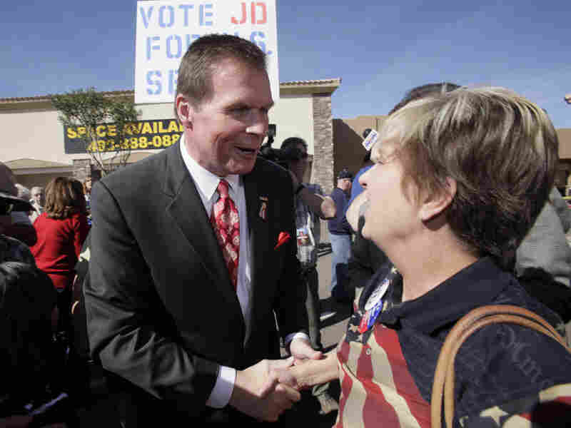 Former Republican Rep. J.D. Hayworth shakes hands with supporters.