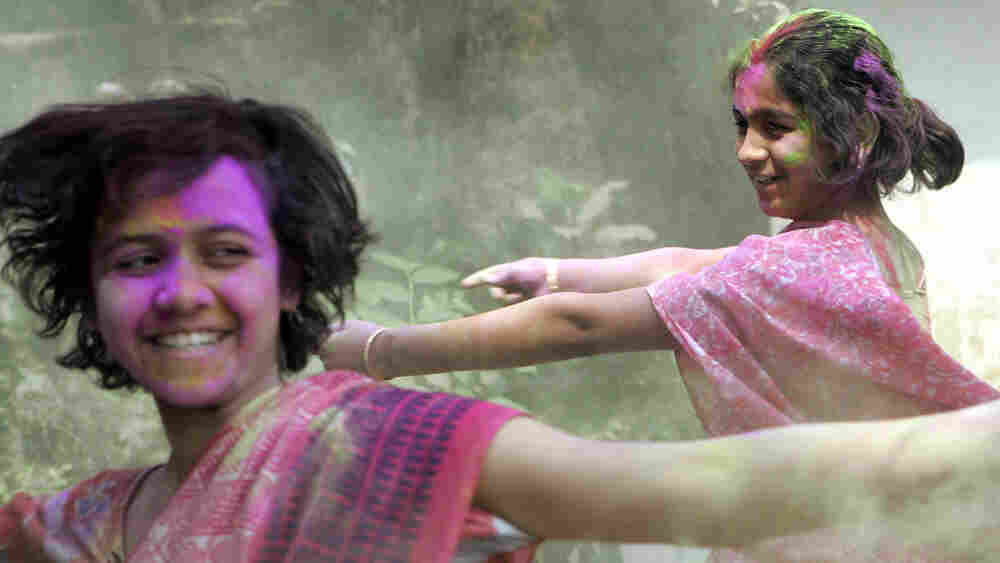 Young Indian girls exchange Aabir dust as they celebrate the spring festival of Holi, or Vasantotsav