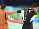 Sven Kramer of Netherlands reacts with coach Gerard Kemkers after being disqualified.