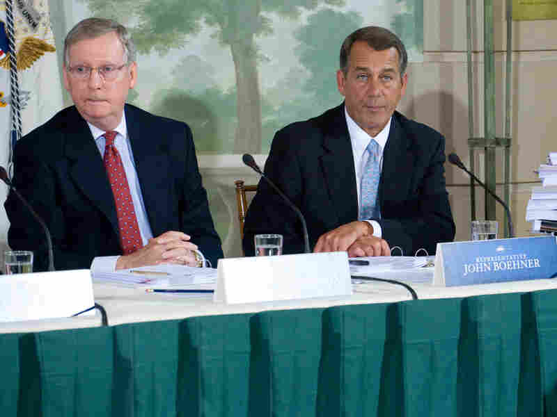Senators McConnell and Boehner listen as President Obama speaks.