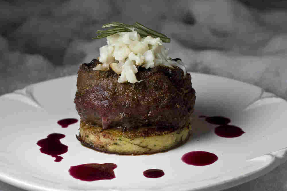 A venison steak served over smashed cauliflower.
