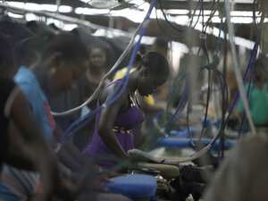 Women work at the DKDR garment assembly factory in Port-au-Prince, Haiti