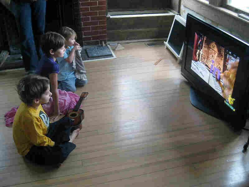 Mac, left, Veronica and Petra Humphrey watch the PBS children's channel.