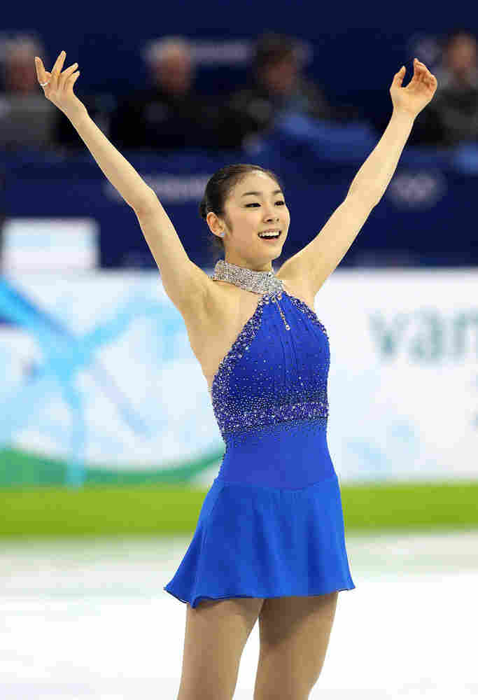 Kim Yu-na of South Korea reacts after her free skate on Day 14 of the 2010 Vancouver Winter Olympics