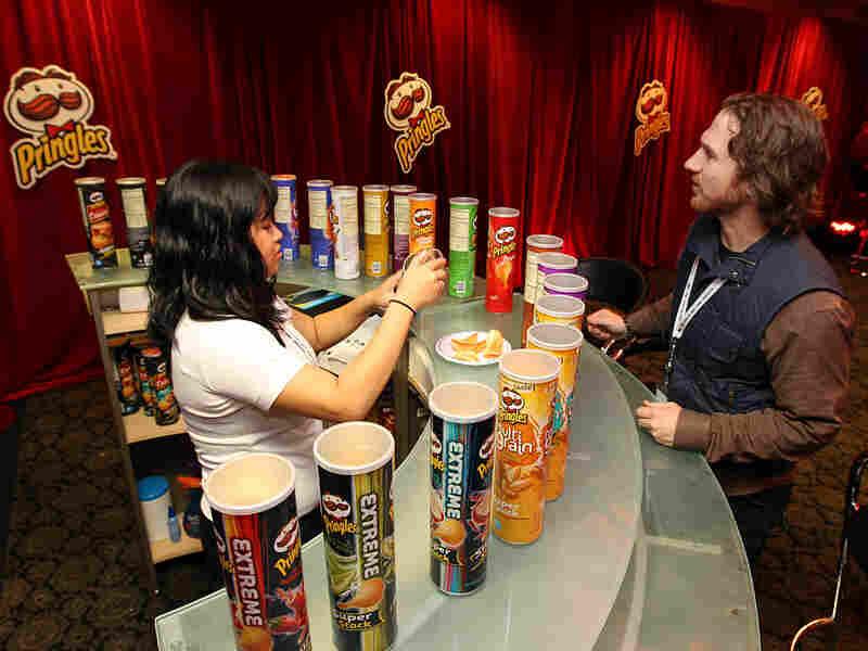 """Snacktender"" Gretchen Cruz serves up chips at the ""Pringles Zone."""