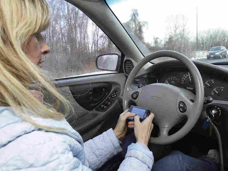A woman texts while driving in Concord, N.H.