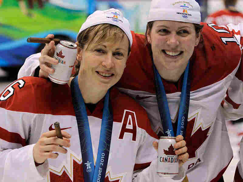 Canada's Jayna Hefford (left) and Gillian Apps celebrate after blanking the U.S. in women's hockey.
