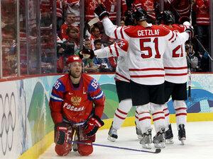 Canadian hockey team celebrating goal against Russia