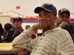 Retired members of the United Auto Workers attend a benefits meeting.