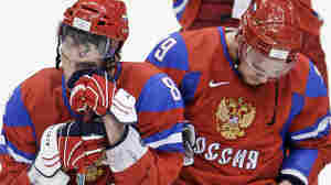 Russia's Alexander Ovechkin (left) and Andrei Markov react to 7-3 loss to Canada