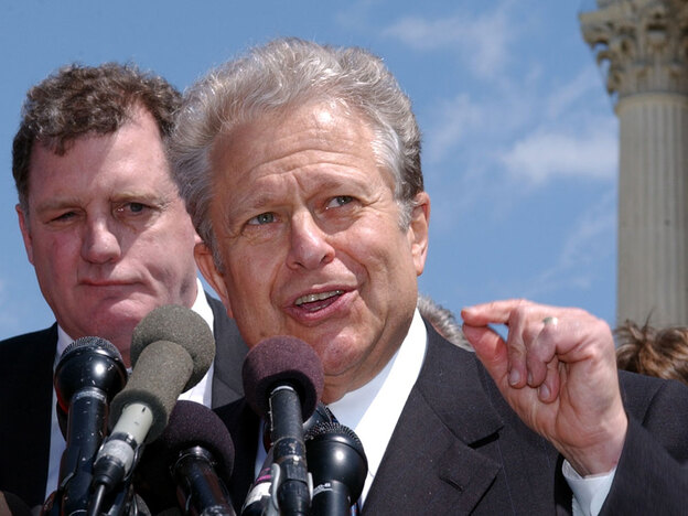 Lawyer Laurence Tribe speaks to reporters outside the Supreme Court in 2003. The Harvard law professor will spearhead a project within the Justice Department to help low-income people receive legal help.