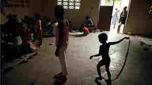 Children play at a school that has been converted into a shelter for quake victims
