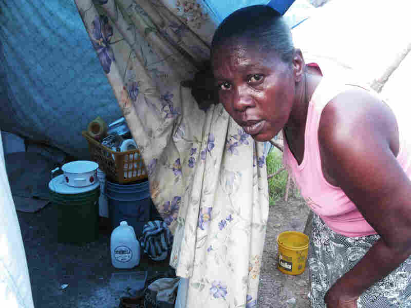 Elizabeth Louis used flour and garbage bags to fashion a shelter for her family