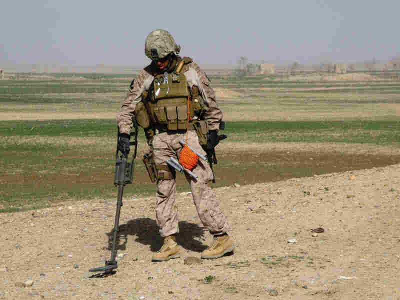 A Marine sweeps for mines in the Taliban stronghold of Marjah.