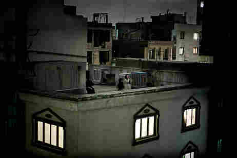 Women shout on a rooftop in protest to the presidential election results,  Tehran, Iran, 24 June (Pi