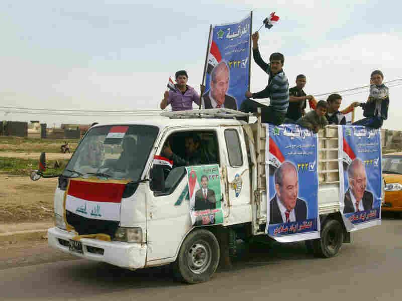 Iraqi supporters of former Prime Minister Iyad Allawi's Al-Iraqiya alliance in Kirkuk