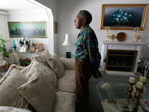 Otis McDonald glances out the window in his home on Chicago's South Side.