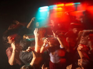 College students dance at a party.