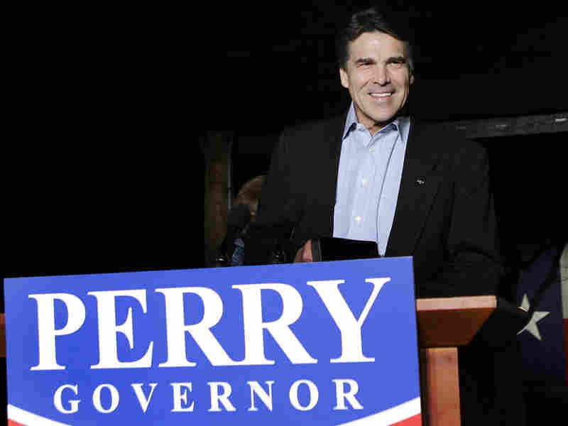 Texas Gov. Rick Perry smiles at his victory party at the Salt Lick BBQ in Driftwood, Texas.