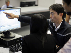 MIT Sloan Fellows participate in a stock market class.